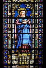 Photo sur Plexiglas Vitrail Saint Genevieve, stained glass window in the Basilica of Saint Clotilde in Paris, France