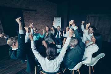 Nice stylish elegant cheerful cheery positive sharks marketers company ceo boss chief directors executive managers raising hands up at industrial loft interior work place space Papier Peint