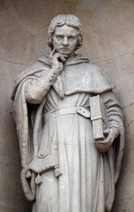 Jean Gerson statue on the facade of the Saint Ursule chapel of the Sorbonne in Paris, France