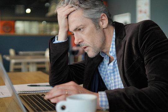 Stressed salesman preparing sales pitch