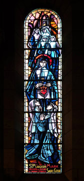 Scenes from the life of the Saint Margaret Mary Alacoque, stained glass window in Basilica of the Sacre Coeur, dedicated to the Sacred Heart of Jesus in Paris, France
