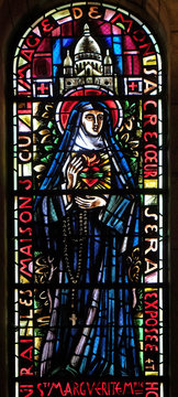 Saint Margaret Mary Alacoque, stained glass window in Basilica of the Sacre Coeur, dedicated to the Sacred Heart of Jesus in Paris, France