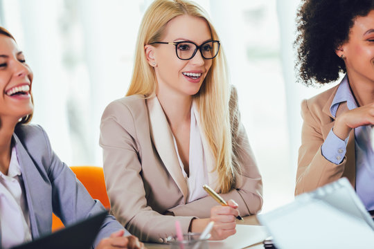 Happy business woman working together in modern office