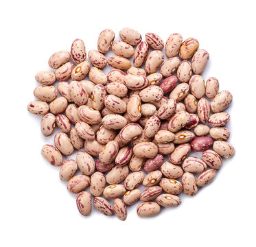 A pile of pinto beans isolated on white background.
