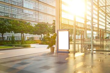 Modern glass facade business office building exterior with floor ,evening scene .