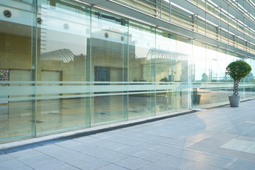 Modern glass facade business office building exterior with floor