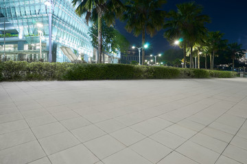 Modern glass facade business office building exterior with floor ,night scene .