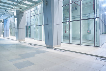 New and empty modern glass facade business office building exterior with floor ,night scene .