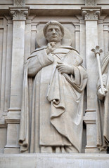 Saints Dominic, statue on the facade of Saint Augustine church in Paris, France