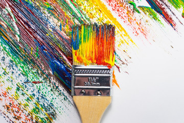 brush and canvas in oil paints