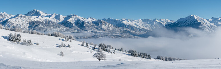 Champsaur Valley, Hautes-Alpes, European Alps, France: Panoramic Winter view on the valley with Chaillol Peak and Autane mountain range from Gleize Pass