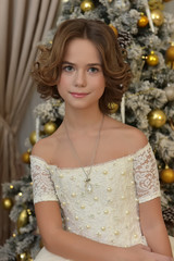 beautiful girl in white dress in christmas