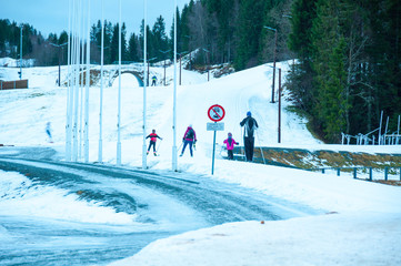 A family of skiers practices on the slopes at Granasen, near Trondheim, Norway