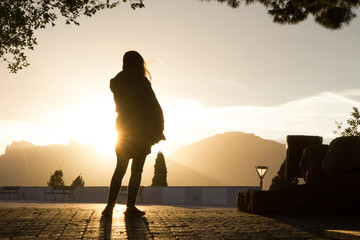 Silhouette of woman against sky during sunset