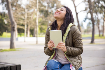 Ecstatic girl with tablet excited about good news