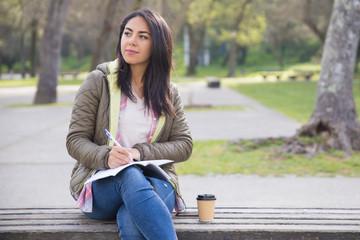 Pensive girl finding inspiration in park