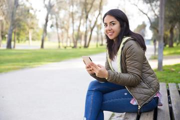 Cheerful attractive girl interacting on social media