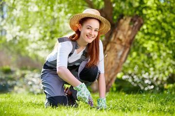Beautiful girl cutting grass