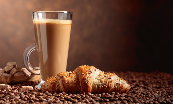 Coffee latte and croissant.