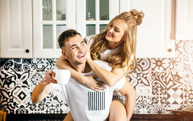 Romantic couple having morning coffee in the kitchen