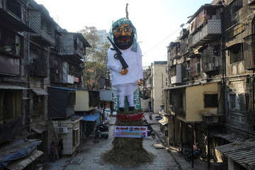 A Holika Dahan effigy of Masood Azhar, the head of Pakistan-based militant group Jaish-e-Mohammed (JeM), is seen before getting burnt on the eve of Holi in Mumbai
