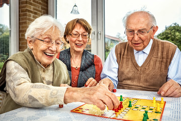 Elderly couple and daughter playing board game, xxl+more: bartussek.xmstore