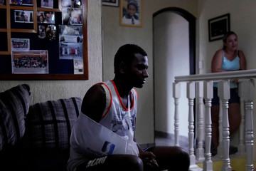 Jose Vitor Ramos Lemos, 18, victim of the shooting at the Raul Brasil school, is photographed at his house after leaving hospital in Suzano