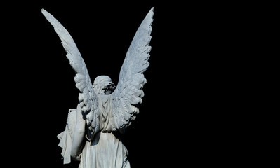 Fototapete - Death and  pain concept. Antique statue of an angel isolated on black background.