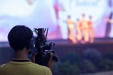 Camera Man Holding Video Camera catch motion in interview or broadcast wedding ceremony, catch feeling, stopped motion in best memorial day concept.