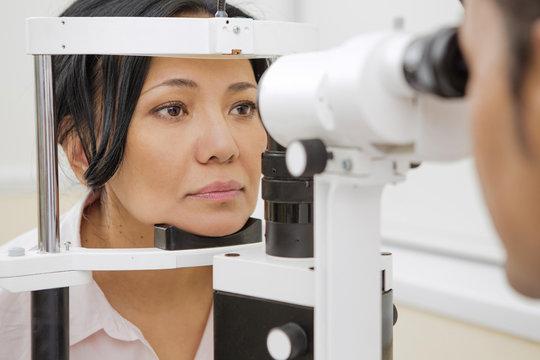 Mature woman having ophthalmological examination