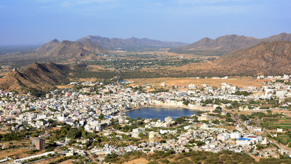 Wall Mural - panorama view from Papmochani Mata Hindu Temple to Pushkar city with holy lake in the center, Rajasthan, India