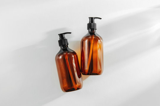Transparent brown Bottles for Shampoo, Soap or other cosmetic on white background..