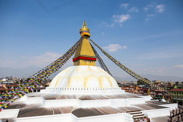 Iconic spherical Buddhist Boudhanath stupa and Kathmandu rooftops seen from a terrace, Kathmandu, Nepal