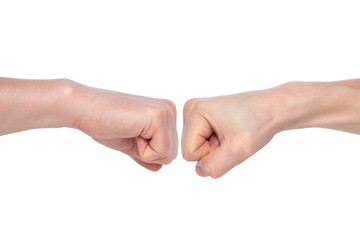 Two male fists hitting each other, isolated on white background. The concept of business success and teamwork. Close-up Wall mural