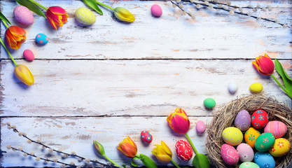 Easter Card - Painted Eggs In Nest And Tulips On Vintage Plank