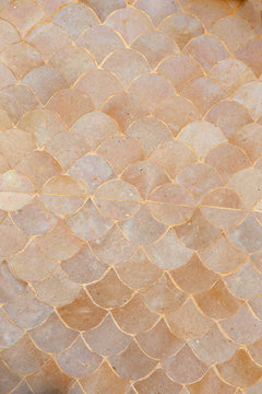 Fan shaped mosaic ceramic pattern wall background texture in cream color