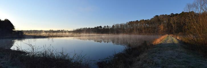 Morning steam fog rises over ponds in Mississippi