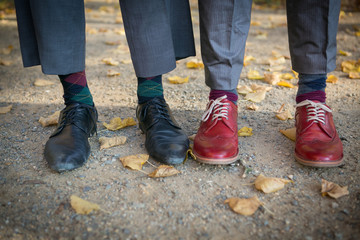 Shoes of two old-fashioned elegant men standing side by side