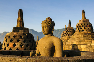Indonesia, Java, Borobudur Temple Complex, Buddha sitting in a stupa
