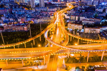 Fotomurales - aerial view of overpass and winding road at night