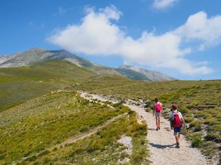 Italy, Umbria, Sibillini mountains, two children hiking mount Vettore