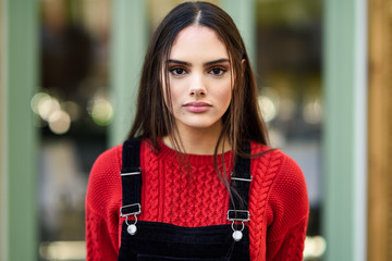 Portrait of fashionable young woman wearing red knit pullover