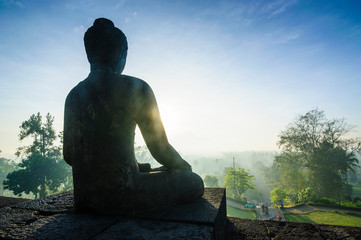 Indonesia, Java, Borobudur Temple Complex, sitting Buddha in backlight