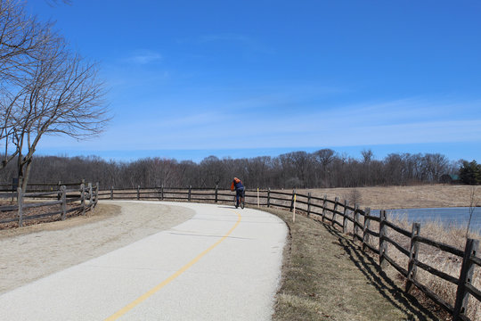 Man with a backpack on bicycle at Independence Grove in Libertyville, Illinois