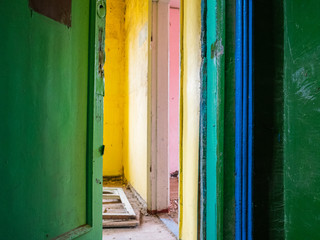 Multi-colored rooms in the abandoned house. The old color apartment where nobody lives