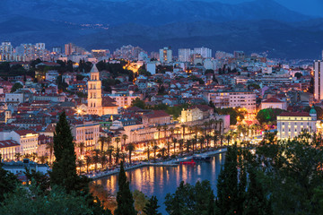 Amazing Split city waterfront panorama at blue hour, Dalmatia, Europe. Roman Palace of the Emperor Diocletian and tower of Saint Domnius cathedral. Split, Croatia.