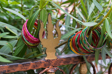 Colorful bangles, bracelets hanging on tree at Sri veeramakaliamman temple, Singapore.