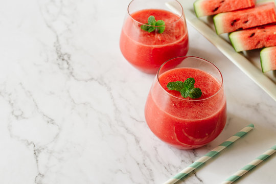 Watermelon drink in glasses with mint. Summer drink concept.