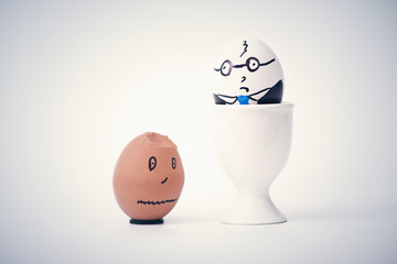 Two eggs white boss and black employee.  Racial discrimination on the workplace