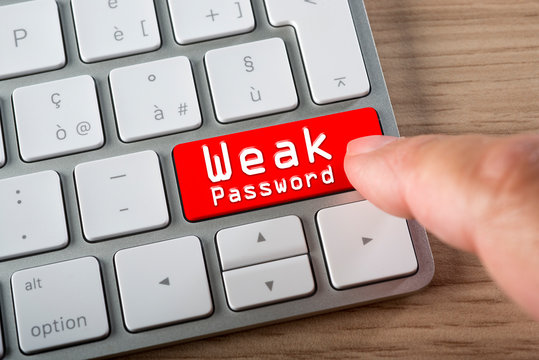 Weak password button on keyboard: concept of online vulnerability and internet threat.